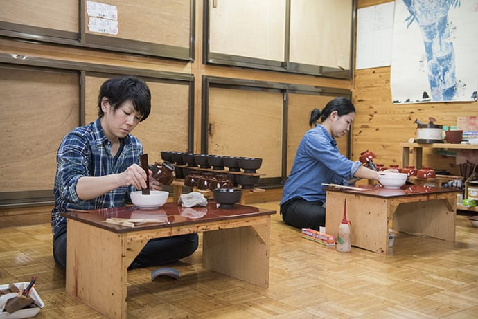 Yumi Misumi (left), a lacquerer for 11 years is involved in event planning and branding aimed at promoting Joboji lacquer.