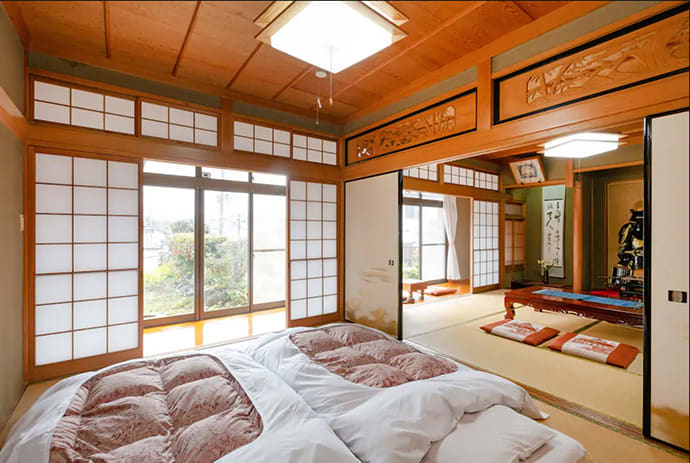 Sleeping on futons laid out on tatami mats is a quintessential Japan experience.