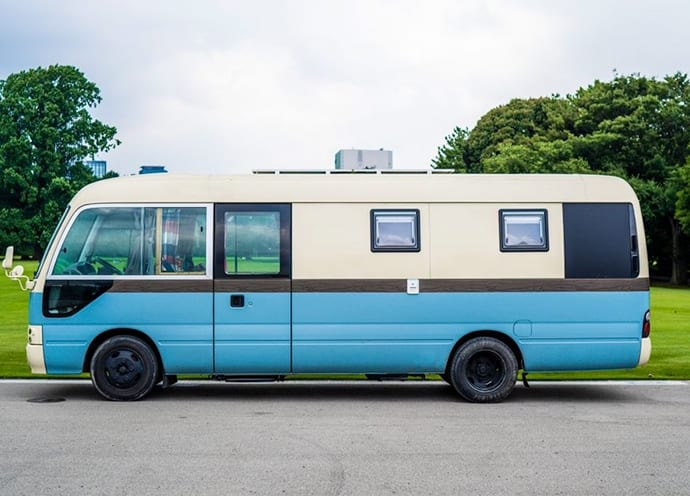 "Converted buses become ""traveling hotels."""