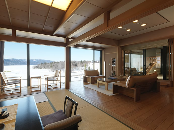 The spacious living room in the Ama no Za suite has views across Lake Akan.