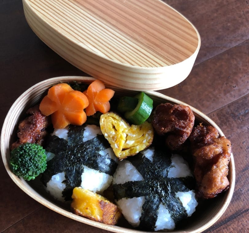 Learn how to prepare a bento lunchbox with seaweed-wrapped rice balls, vegan eggs shaped like hearts and carrots cut in the shape of flowers.