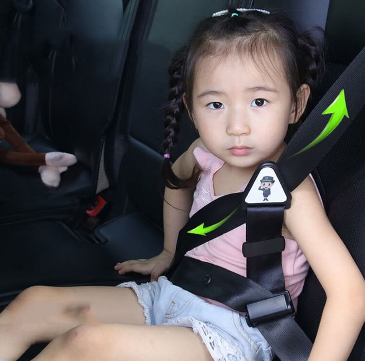 photo of seat belt adjuster for child applied in car with a child in the car seat
