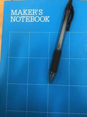 maker notebook and pen