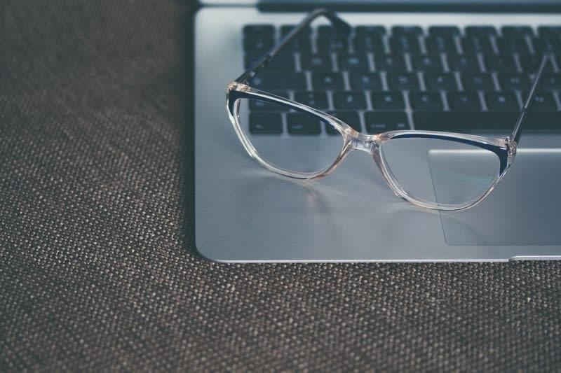 glasses resting on laptop