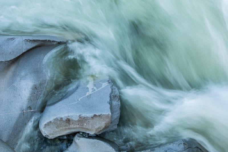 waves swirling around rocks