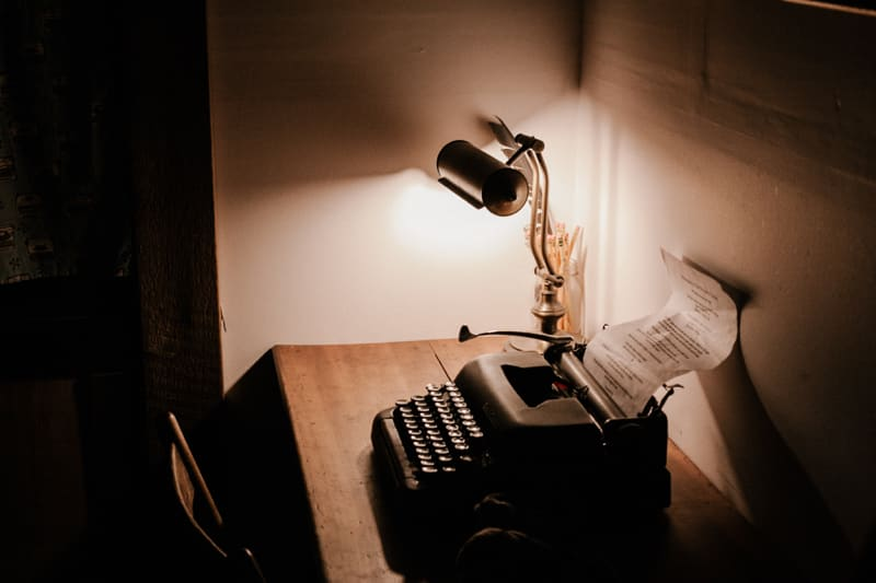 typewriter on a desk with lamp