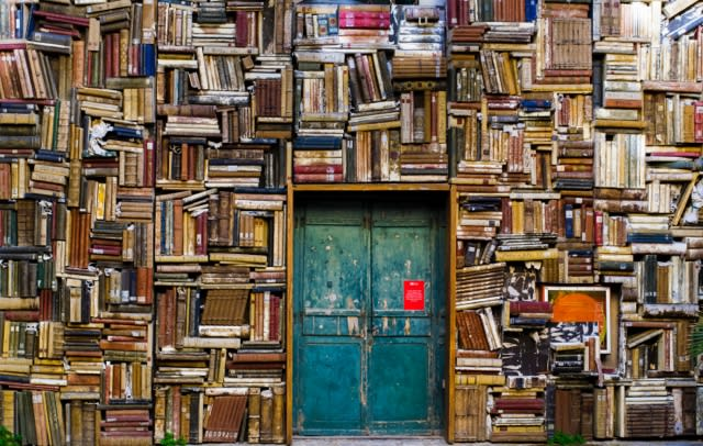 door surrounded by books