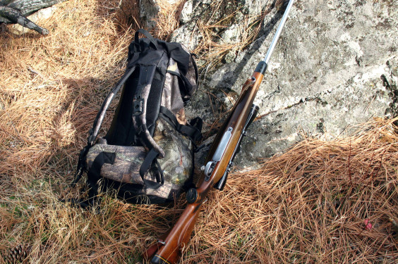 Rifle and backpack