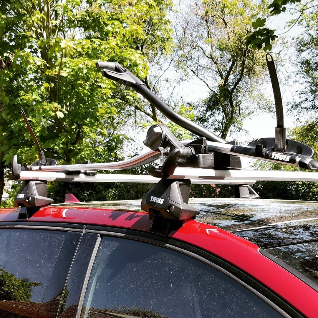 Roof bars and bike carrier on the roof of a car