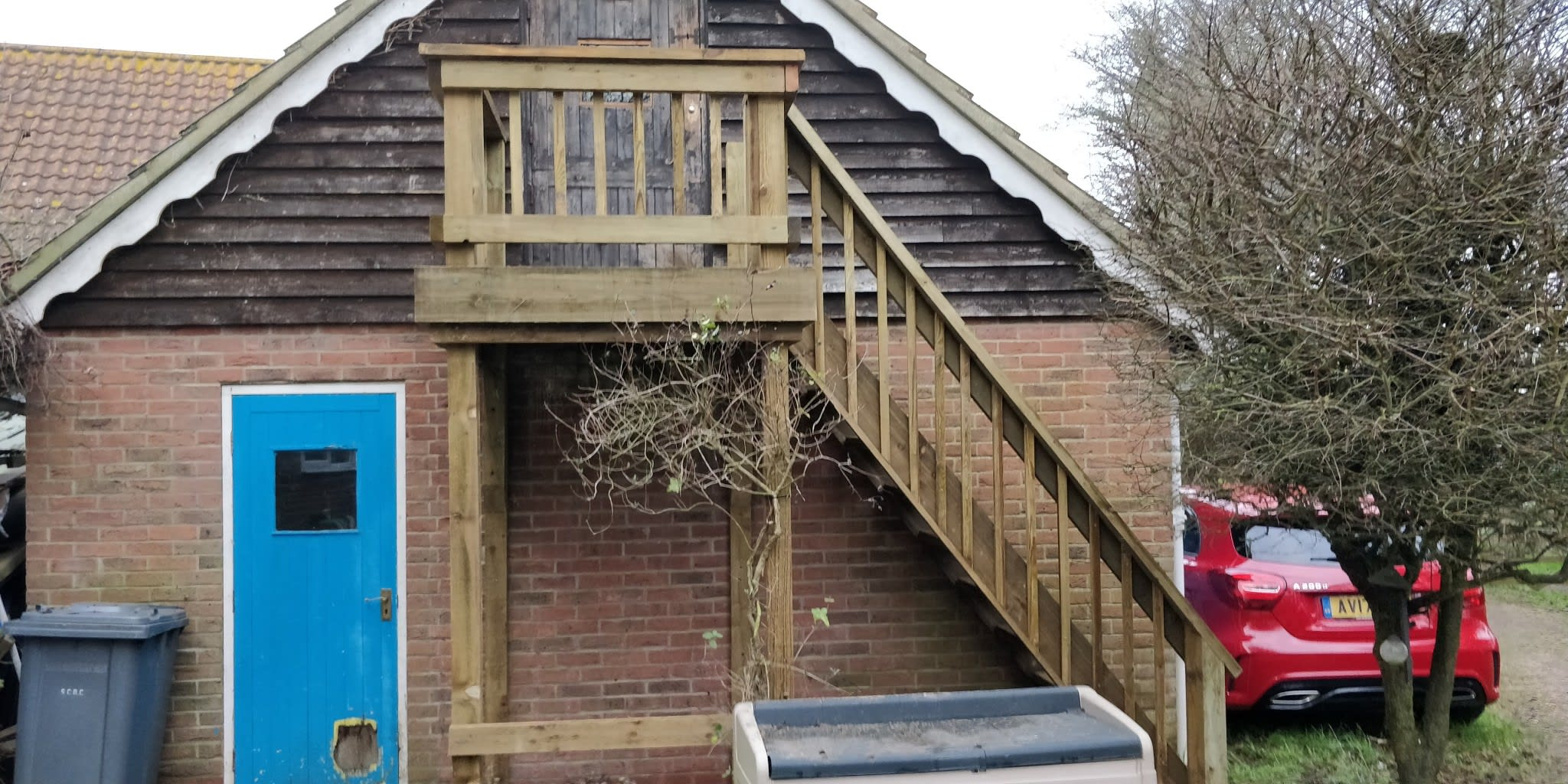External staircase going into office space above double garage