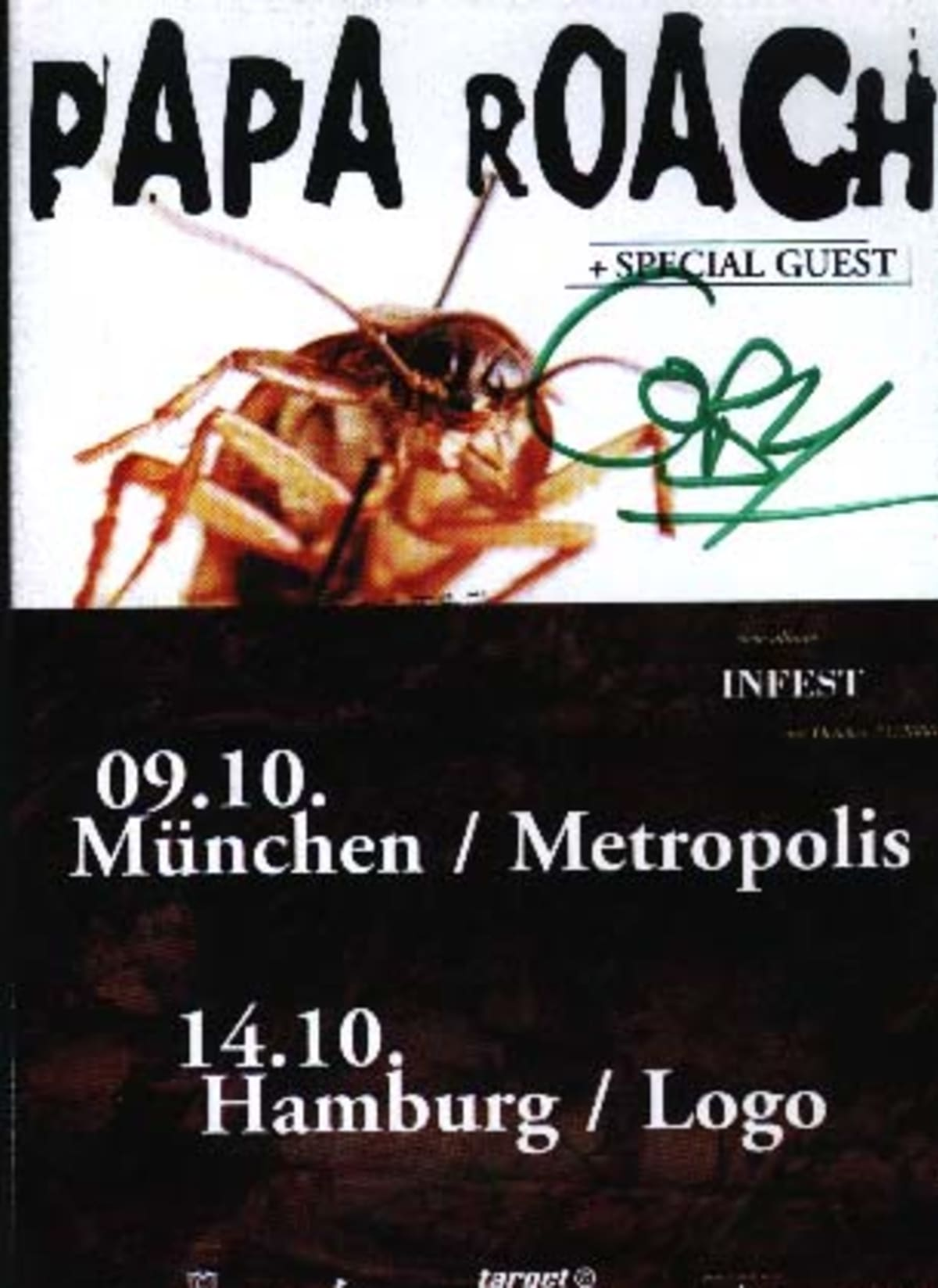 Coby Dick, singer of Papa Roach, autographs a flyer from their European tour