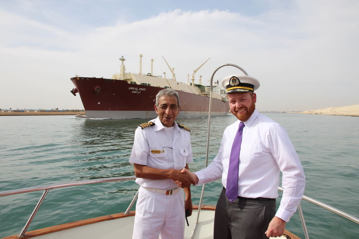 Shaking hands with the captain on the bow of the Egyptian Presidential Yacht on the Suez Canal