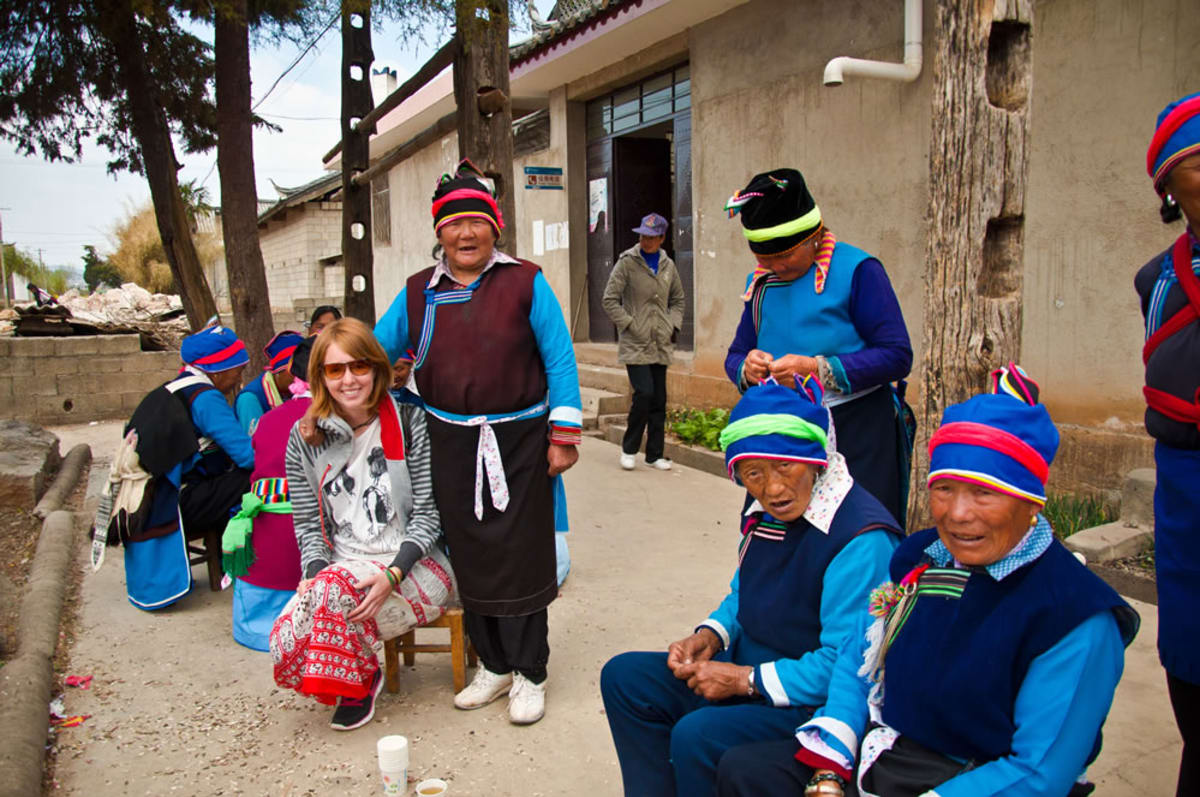 Aniko Villalba visits with inhabitants of a small village in China.