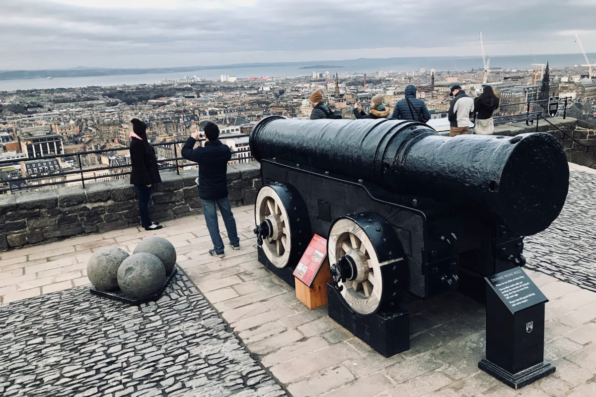 Mons Meg pointed out to the harbor below Edinburgh Castle