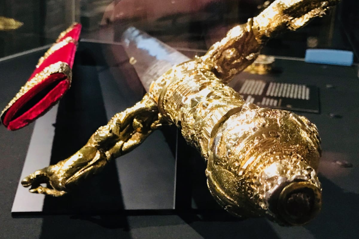 A detailed view of the gilded hilt of the Irish Sword of State
