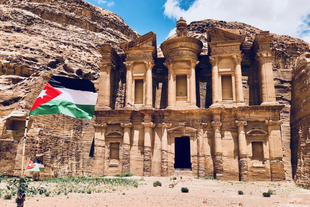 The Monastery at Petra with a Jordanian flag