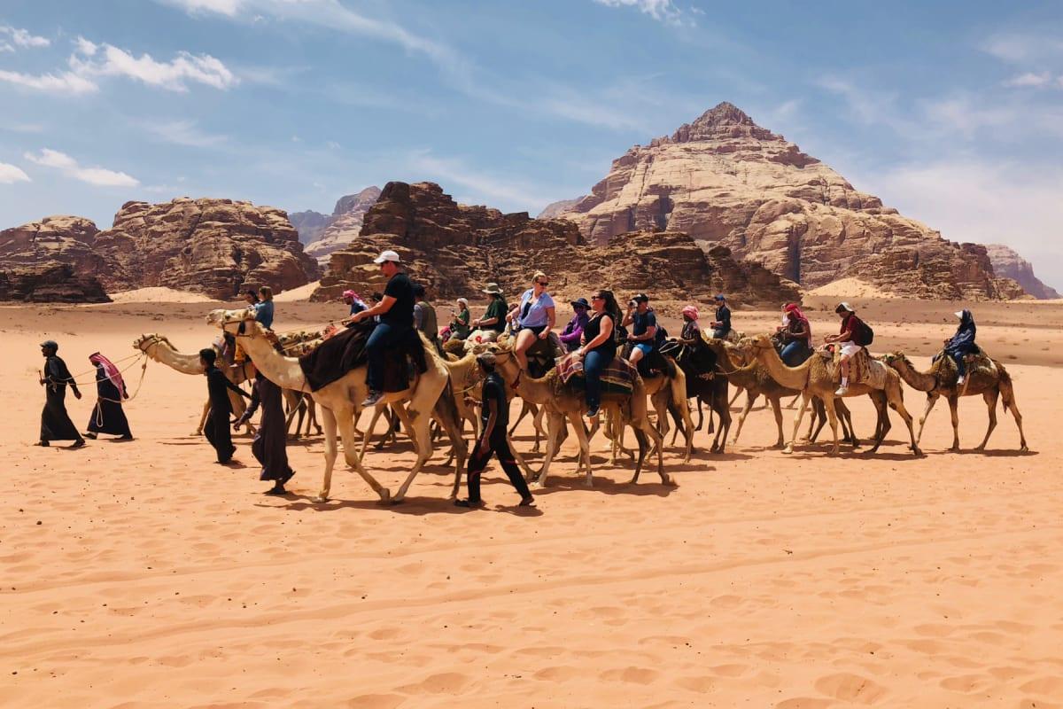 A tour group takes a camel safari in the Wadi Rum Desert in southern Jordan