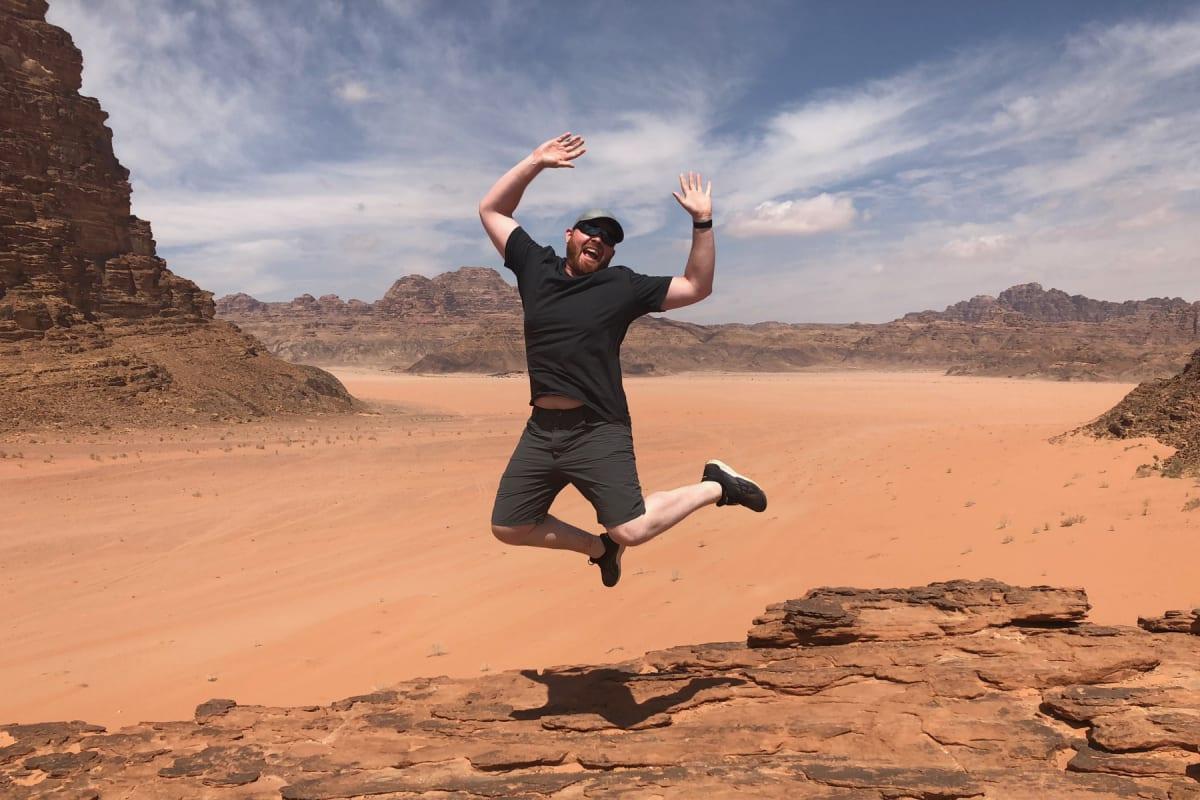 Judson jumping for joy in the Wadi Rum desert of Jordan