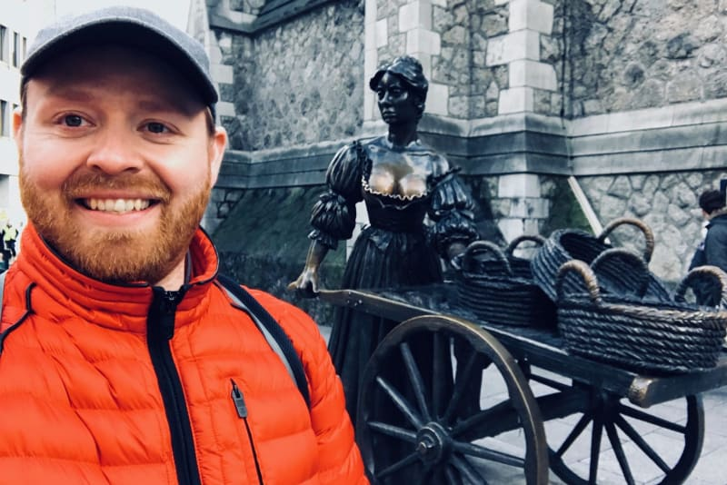 Judson stands in front of a statue of Molly Malone