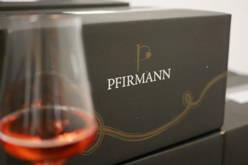 Box and glass of Secco from Pfirmann Weingut