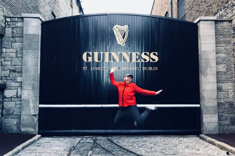 Judson jumps in the air in front of the Guinness Storehouse