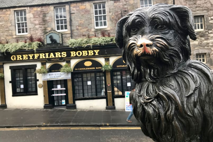Greyfriars Bobby Memorial Statue with the Greyfriars Bobby Pub in the background
