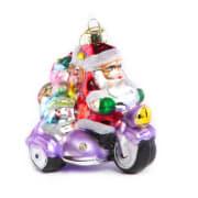 Hengepynt nisse på lilla scooter