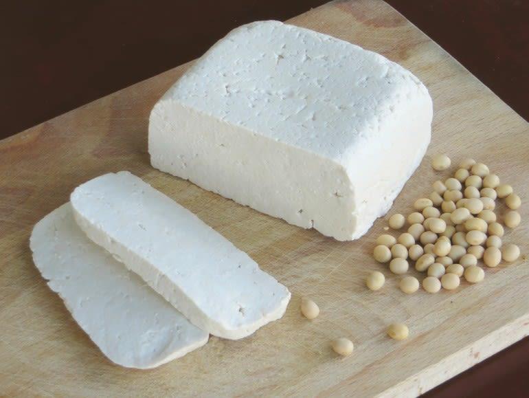 Tofu on a wooden cutting board