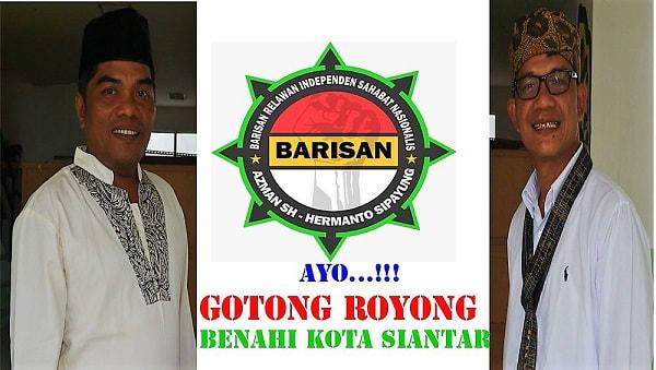 Pasangan Azman SH dan Hermanto Sipayung