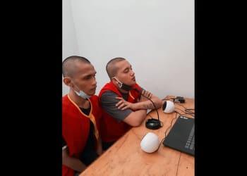 Terdakwa James Manurung alias James dan Sakau Feriandri Simorangkir alias Sakau saat disidang Virtual di PN Siantar
