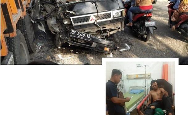 Barang bukti truk fuso dan mobil mitsubishi L 300 pick up serta Jesman Sirait supir mobil mistubishi L300 pick up kondisi luka luka
