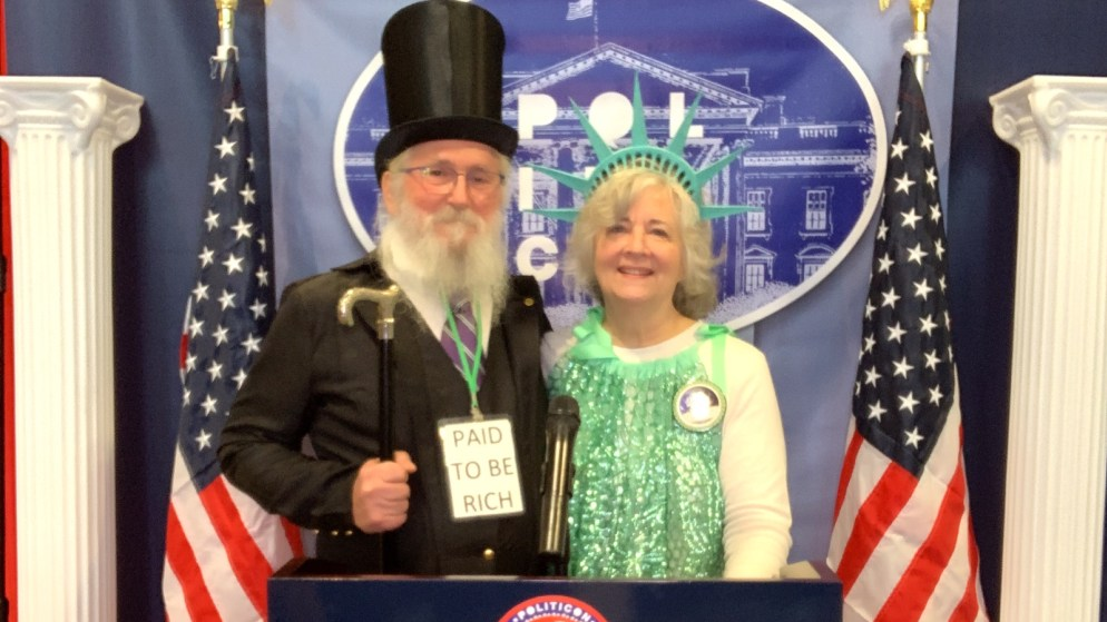 Howard Switzer and Virginia Hammon and a team of six at Politicon in Nashville, TN.