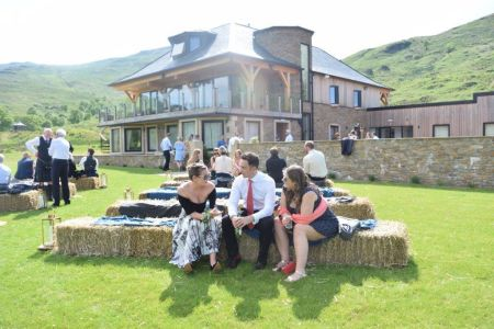 Rustic Romance in the Estate Barn Hay Bale ceremony