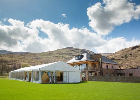 Traditional Marquee next to Loch Marquee at the estate