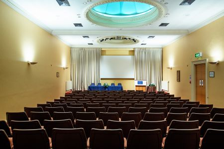 Wolfson Lecture Theatre  With decorative cornicing, the neutral tones of this bright, air-conditioned theatre enable you to brand this space.