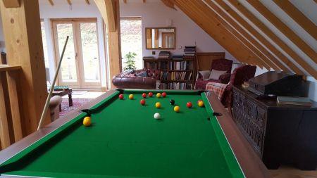 Intimate Weddings Pool table in the upper galler