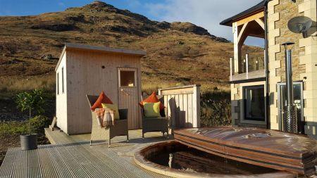 Intimate Weddings Hot tub and sauna with mountain views