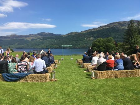 Traditional Marquee next to Loch Laid back ceremony on the lodge lawn