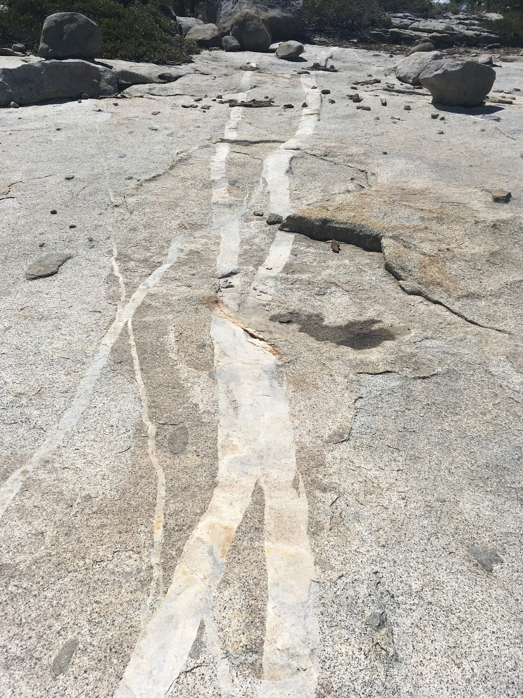 White strips of some other rock type running through granite.
