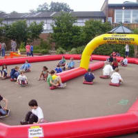 Wiggle Cars And Inflatable Race Track