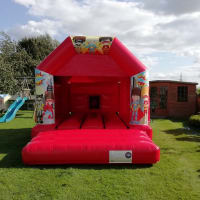 Red Super Hero Disco Bouncy Castle