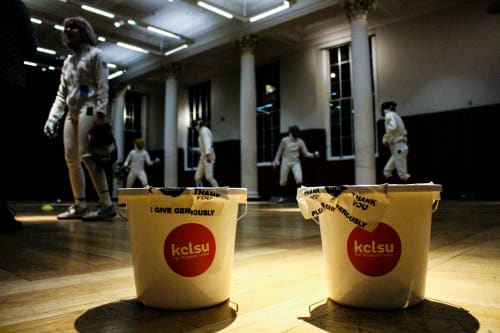 Fundraising buckets and fencing group