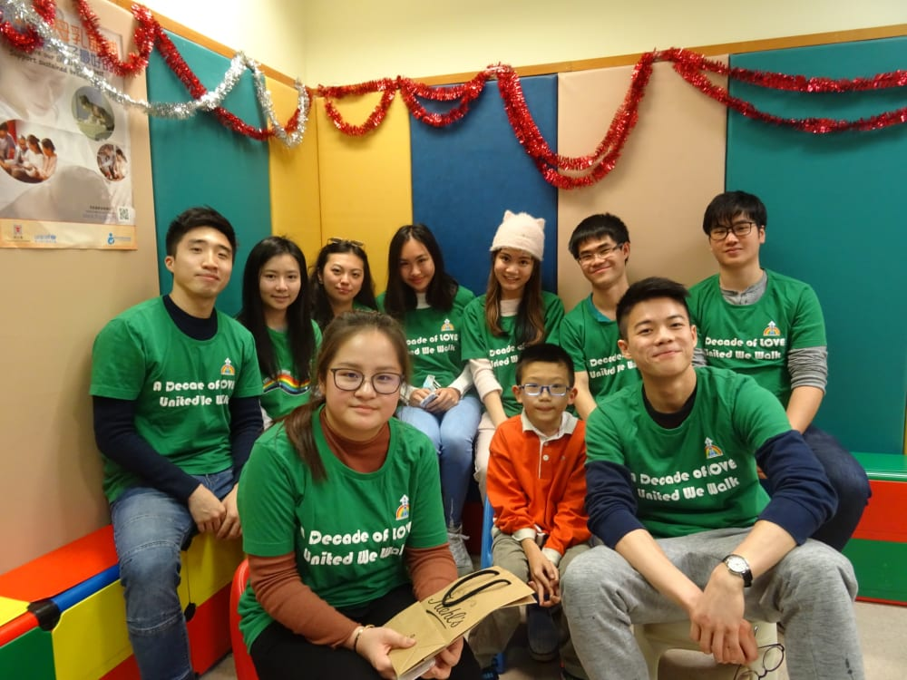 student volunteers pose for photo