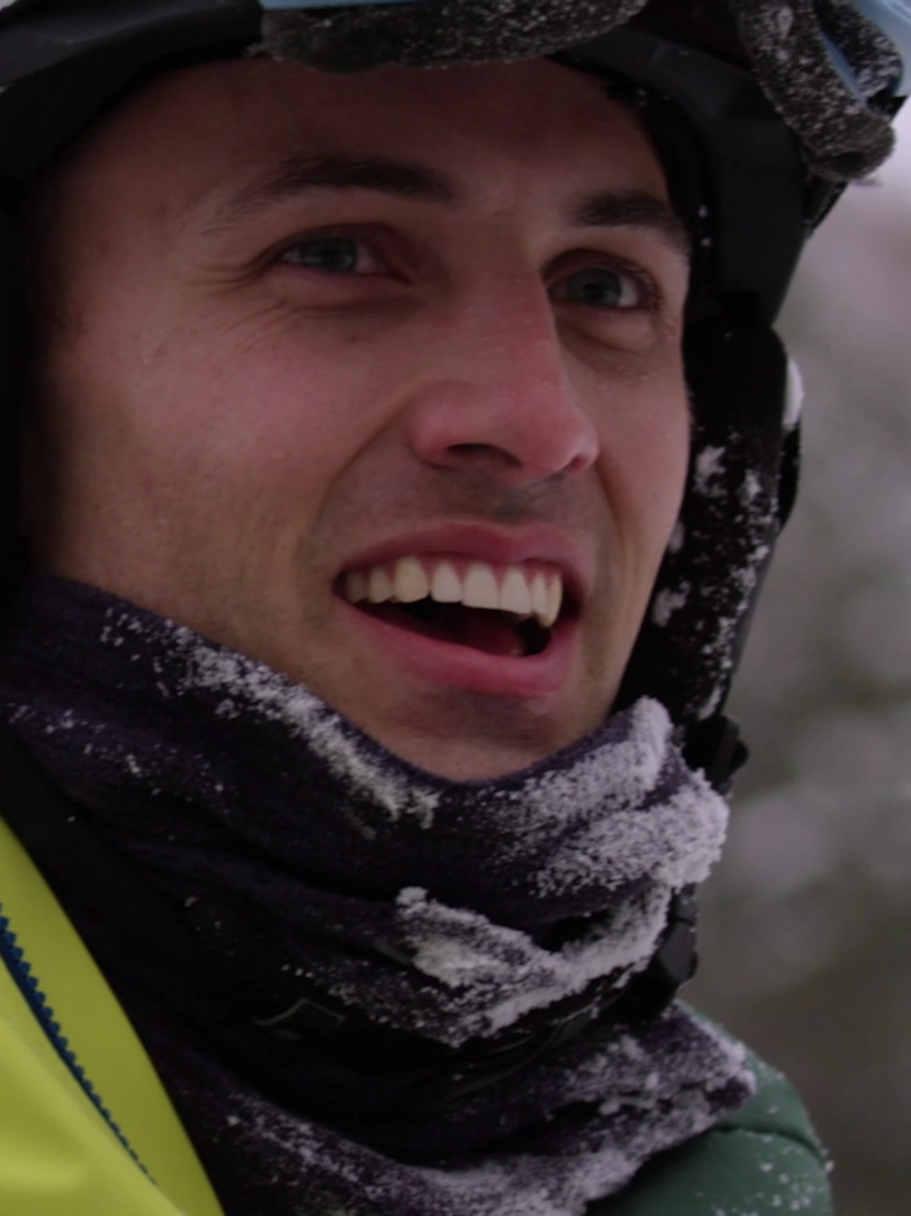 Kent smiling covered in snow