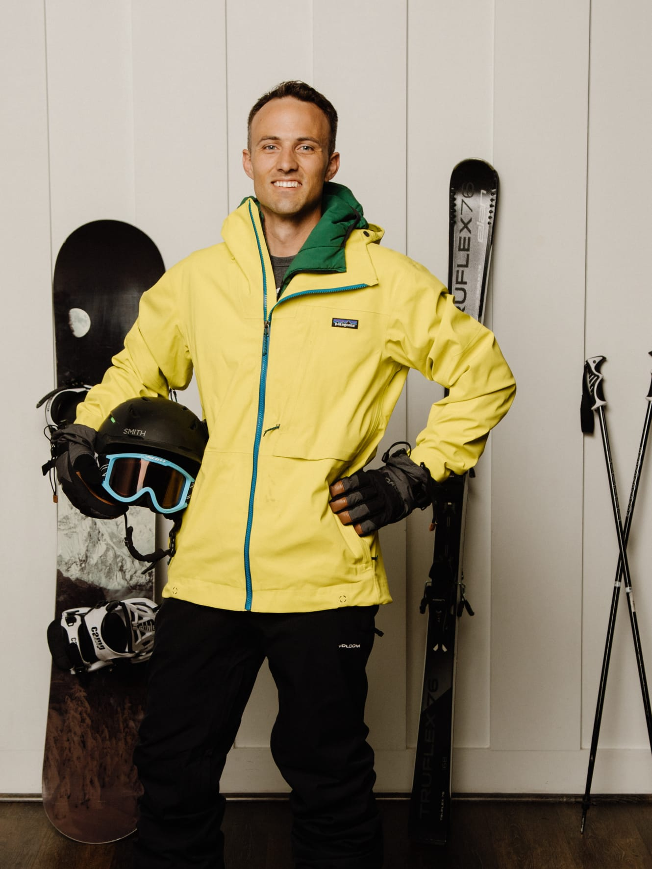 Kent wearing snow clothes with skis and a snowboard