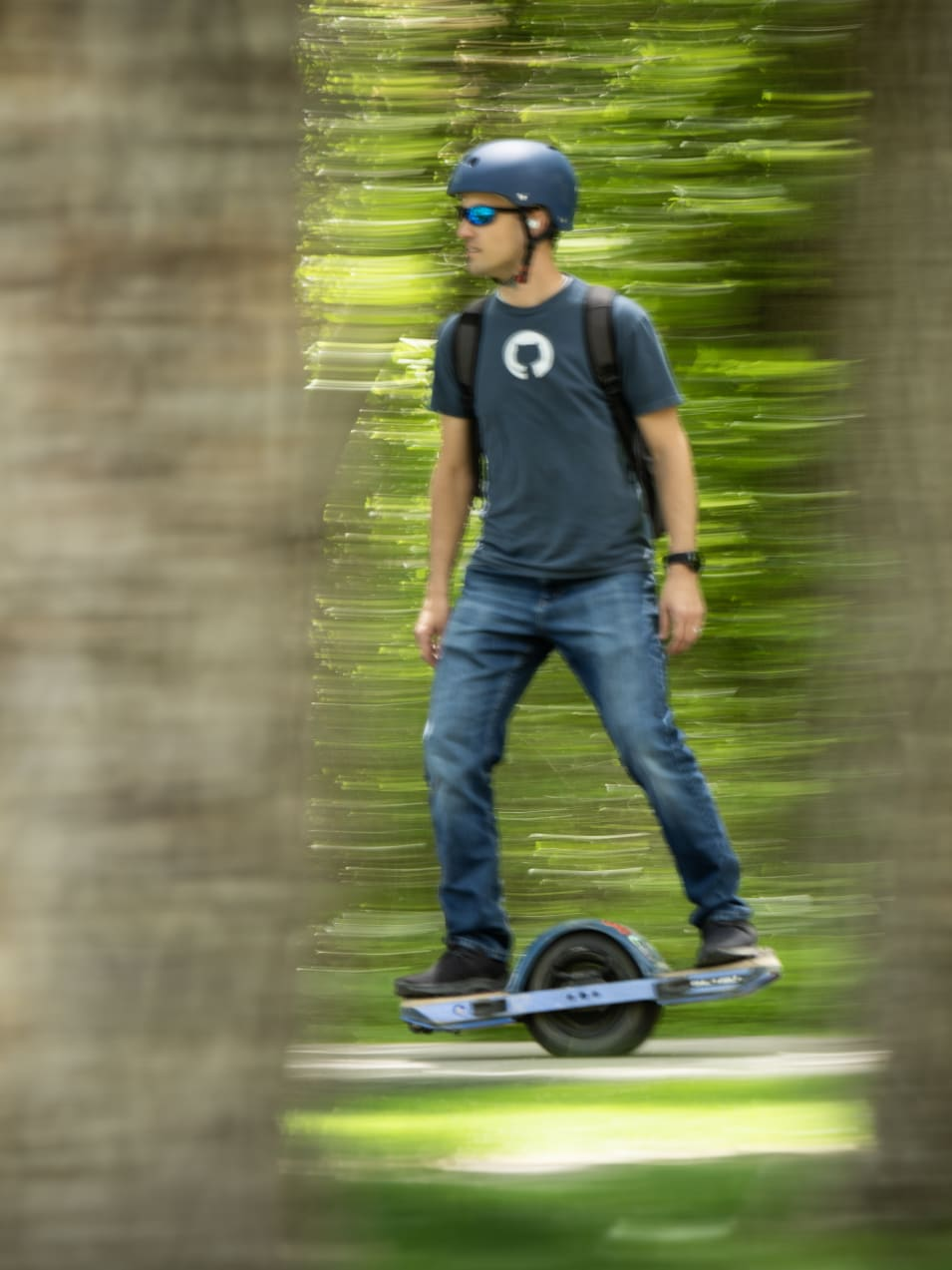 Kent riding on a onewheel in the outdoors