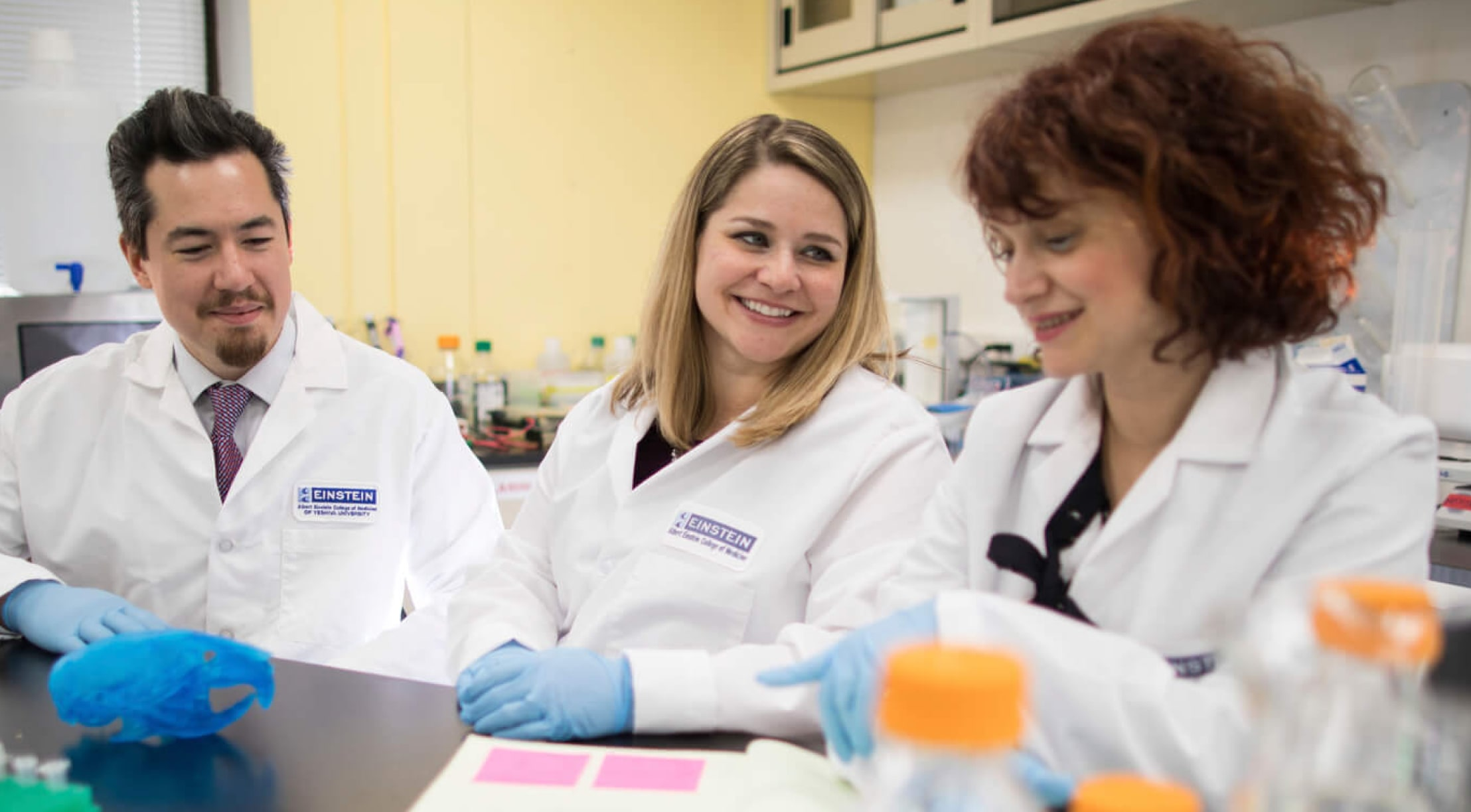 Dr. Autry working with fellow researchers in the lab.