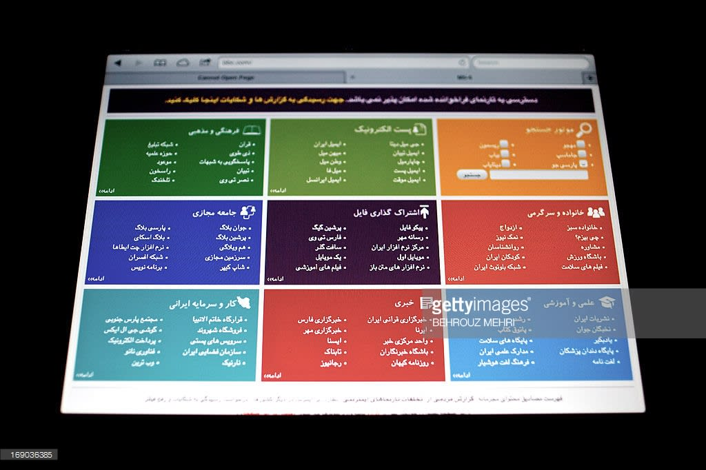 """TO GO WITH AFP STORY BY MOHAMMAD DAVARI - A picture taken of the screen of a laptop shows a webpage that appears when an Iranian user tries to visit websites which are blocked by the government, on May 13, 2013 in the Iranian capital Tehran. The top line reads in Farsi """"Year of political and economical epoch,"""" referring to supreme leader, Ali Khamenei who has named the new Iranian year and the bottom line reads in Farsi """"Congratulation for the birthday of Fatima, Prophet Muhammed's daughter, Happy Mother's Day and Women's Day."""" Iran is tightening control of the Internet ahead of next month's presidential election, mindful of violent street protests that social networkers inspired last time around over claims of fraud, users and experts say. AFP PHOTO/ATTA KENARE"""