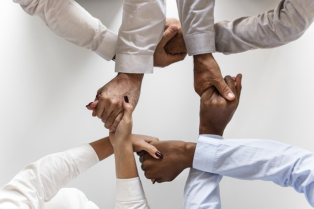 team motivation holding hands