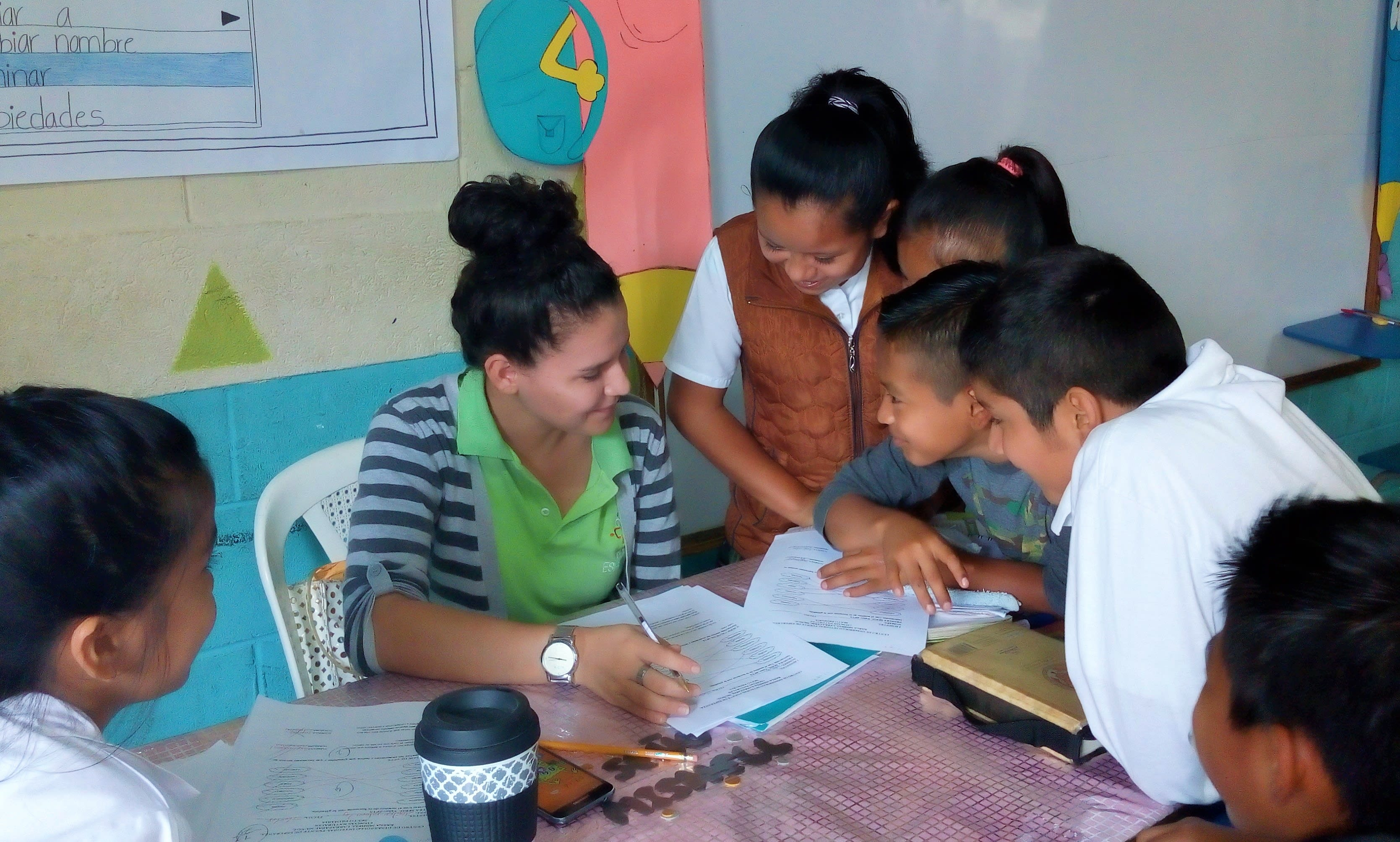 Source of Hope Kids gathering by teacher